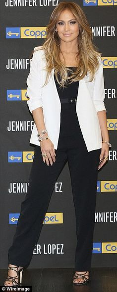 Looking like a CEO: The mother-of-two looked the epitomy of business casual chic when she stunned in a black jumpsuit and white blazer