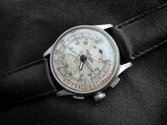 I want a cool vintage watch. Like this old Tag Hauer. Adds a good bit of history to your modern wear.