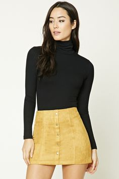 A faux suede mini skirt featuring a front button placket and a concealed back zipper.