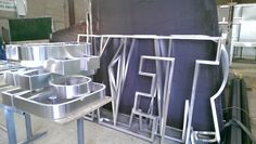 Hand manufactured Aluminium letters during production.