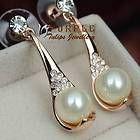 18CT Rose Gold Plated Sparkling Elegant Pearl Stud Earrings W/ Swarovski Crystal - http://fine.designerjewelrygalleria.com/swarovski/swarovski-earrings/18ct-rose-gold-plated-sparkling-elegant-pearl-stud-earrings-w-swarovski-crystal/