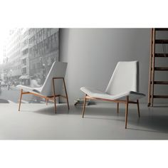 The geometric angles of the Kent Lounge Chair give it the austere air of minimalist design. Yet the comfort padding on the seat and tapered back, the mix of leather and premium tweed fabric, and the s