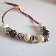 Cool looking surfer bracelet featuring Bone Wooden and Silver Beads on Leather Bracelet.  Are you looking for fun jewelry and other items. Check out SpuzzosDeals.com #jewelry #spuzzosdeals #necklace #necklaces #bohostyle #bohostyles #hippie #hippies  #neckless #bohostyles #bracelet #bracelets #surfers #surfing  #mensbracelet #mensbracelets #hippiestyle  #hippiechic  #bohemianfashion  #bohemianjewelry #bohemianstyle #gypsystyle #chakrahealing #braceletlove