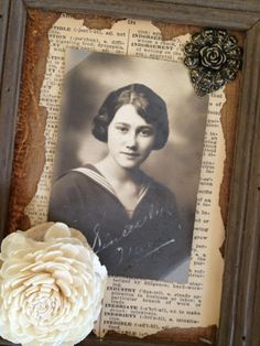 Interesting heritage page with distressed vintage dictionary background and flower embellishments.