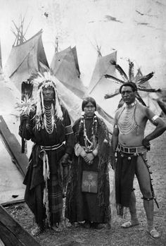 """thebigkelu: """"Strong Eagle, Simon Silas and a Native American Spokane woman pose in front of a row of tepees, Washington State - """" Native American Images, Native American Beauty, American Indian Art, Native American Tribes, Native American History, American Indians, American Symbols, British History, American Women"""