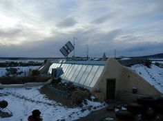 Earthships!  Pioneered by Michael Reynolds of Taos in the late 1970s. Great for 30 below winters