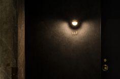hotel door Interior signage designed by UMA for Onomichi based Hotel Cycle Storefront Signage, Hotel Signage, Wayfinding Signage, Signage Design, Hotel Corridor, Hotel Door, Front Door Lighting, Fence Lighting, Architectural Lighting Design