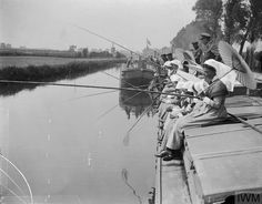 Nurses of the QAIMNSR (Queen Alexandra's Imperial Military Nursing Service Reserves) or the TFNS (Territorial Force Nursing Service) taking part in a fishing contest between the nurses of hospital barges. Watten, 8 June Watten is. Cross Flag, Red Cross, World War One, First World, Scottish People, Vintage Nurse, School Pictures, British Army, National Museum