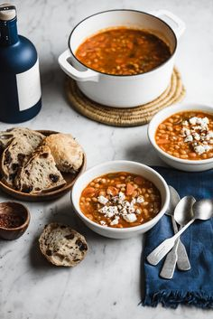 One of the most beloved Greek recipes, Fasolada - Greek White Bean Soup is a simple, nourishing comfort food that pairs beautifully with a bit of crumbled feta, olives, and crusty bread. #mediterraneandiet #mediterraneanfood #beansoup #soup #healthysoup #greekrecipes #fasolada