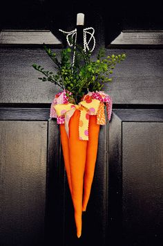 Definitely wouldn't be able to pull this off, but its adorable. Carrots on the door for the Easter bunny.