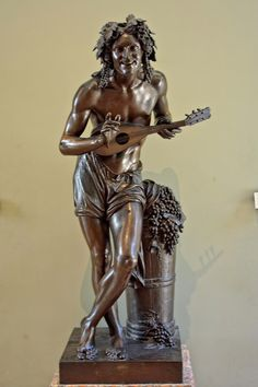 what a lovely statue of Bacchus :) he's so cheerful and happy :)