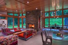 A Vermont mountain getaway nestled into a heavily wooded site