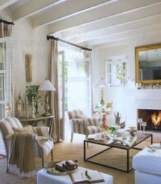 tans and whites; neutrals and stripes in front of the fire