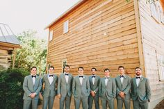 The groomsman sport gray suits, succulent boutonnieres, and navy bow ties with different patterns Barn Wedding Venue, Farm Wedding, Rustic Wedding, Wedding Ideas, Succulent Boutonniere, Boutonnieres, Groomsmen Accessories, Gray Suits, Wedding Checklist Printable