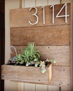 Custom made wooden planter with address numbers. Choice of vertical or horizontal numbers depending on how many. 4 numbers is the max amount of numbers that can be done. If you would like more its an additional $20 since more material has to be used. Reclaimed wood. Modern style raw metal numbers. Succulents are not included. Includes hook for easy mounting. 16 x 21 is the first picture, however, varies with number amount. Letters are 5 tall.