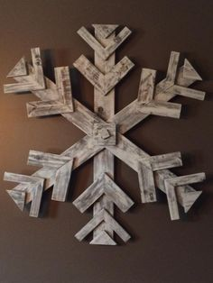 """40"""" diameter snowflake made for my awkwardly bare dining room. Some leftover boards, a jigsaw & a speed square with some screws through the back & glue. Voila! Instant wall decor for the Holidays & winter. Walnut stain & chalk paint makes scrappy old boards look chic."""