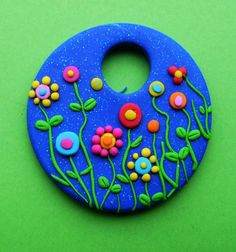 Fimo Polymer Clay Necklace Medallion flowers over by Coloraudia