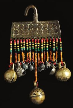 """Indonesia ~ Borneo   """"This large cast ear pendant (Metal, metal alloy, possibly 16th century or earlier), with spiral ornament, cast bells and glass beads, found in east Kalimantan, is of a rare type""""   Source: 'Gold Jewellery of the Indonesian Archipelago'"""