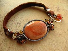 Agate, tundra sapphire, tourmaline, and sun stone on sterling silver wire and soft leather bracelet