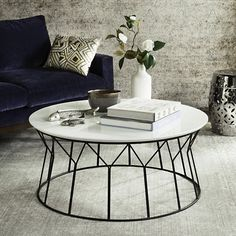 Reminiscent of a vintage design classic, this Safavieh Deion Retro Mid Century Wood Coffee Table is an investment. Ideal for any interior, its smooth top features a neutral grey palette, while the sleek lines of its iron base ensure a lightweight feel. Mid Century Coffee Table, Black Coffee Tables, Round Coffee Table, Modern Coffee Tables, White Coffee, Coffee Desk, Coffee Mugs, Coffee Beans, Coffee Shop