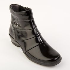 Dysis Ladies Boot E-EE - Plain styling and sweeping lines, along with a leather covered heel, makes a very distinctive ankle boot.