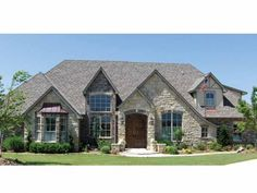 French Country , 4 Bedroom , 1 Story  The beautiful stone exterior opens to a luxurious one-story floor plan. The entry hall is flanked by a study and dining room with vaulted ceilings, and then leads to the great room with built-ins and a wall of windows. The great room is open to an eat-in kitchen with a convenient center island and bayed breakfast nook
