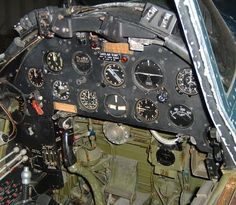 Look inside an F4U-1A cockpit. And yes, it's missing the gun sight at the top center of the panel. Via the Warbird Information Exchange.