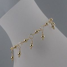 This pretty anklet is an ideal adornment for a sensual, stylish woman. It is made with14k gold filled beads that dangle from 14k gold filled rings and fastens with a 14k gold-filled lobster clasp. Ple