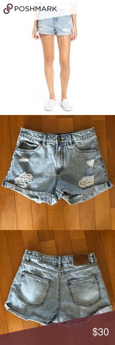 """Billabong overdrive light wash distressed shorts Raw, turned-up cuffs lend a laid-back, leggy look to these distressed denim shorts in an ocean-blue wash. 2 1/2"""" inseam; 11 1/4"""" rise. Zip fly with button closure. Five-pocket style. 100% cotton. Waist 27"""", length 12.5"""" Billabong Shorts Jean Shorts"""