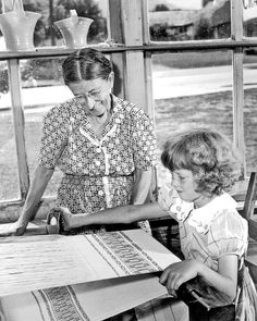 Mrs. Amos T. Trentham teaching her granddaughter, Peggy, to weave | Gatlinburg, Sevier County, Tennessee, U.S.A. | c. 1946