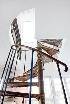 I love spiral staircases...  It would be awesome to have some when I own a house :)