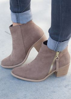 Make room in your closet, these transitional booties will be your best friend this fall! This simple and chic style features a faux suede upper, western-style paneling and stitching detail, size zippe