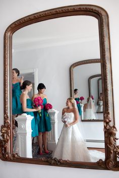 Teal bridesmaids with hot pink bouquets - love this