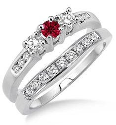 2 Carat Ruby & Diamond Elegant Three Stone Trilogy Round Cut Bridal set on 10k White Gold. The sparkle of Ruby Gemstone along with glittering diamonds in this beautiful Ruby and diamond engagement ring wedding set would make her fall in love. The inexpensive Ruby and diamond gemstone bridal ring would be an instant family haireloom.| Price:$699.00 USD on Shygems