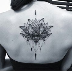 women lotus tattoo on back