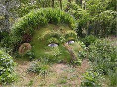 mud sculpture head at heligan