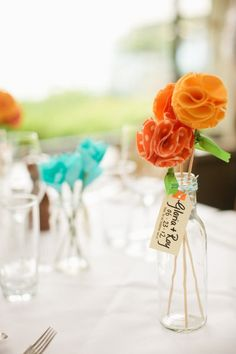 I think Tangerine and Turquoise would look nice on the table together. Maybe Turquoise, Tangerine and a Silver accent?