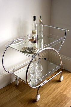 art deco drink trolley. Much nicer with the mirror tray rather than the laminate.