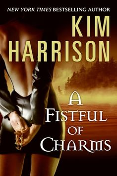 Kim Harrison's A Fistful of Charms, original mass market release July 2006. The hard cover publication used the same artwork, and is is currently the most difficult book to find.