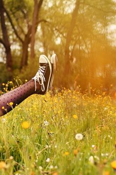 """"""" ....there she was in that dandelion spangled field, sneakers on with those polka dot tights, hair tangled with dandelion dust, laughing as she drank in more and more of that radiant sunlight. that's how i wanted to remember her. drunk on sunshine and with the idea that life was about being alive..."""""""