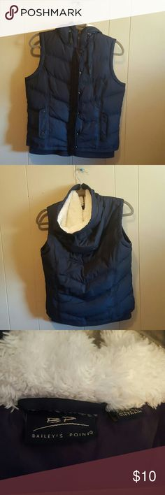 Hooded Puffy Vest Navy blue with purple lining and white fuzzy hood. Has drawstring around hood, zipper and snap button closure, and snap closure pockets at hips. Excellent condition. Bailey's Point Jackets & Coats Vests