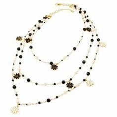"Bring a touch of elegance to your evening ensemble with this layered necklace, featuring black and white faux pearl accents.   Product: NecklaceConstruction Material: Faux pearl, brass, resin, and enamelColor: Black and whiteFeatures:  Lobster claw closure10"" DropDimensions: 24-26"" Chain length"