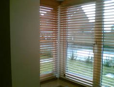 Wooden blinds in a square bay.