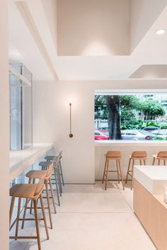 Lukstudio has revived an empty corner lot in a residential district of Guangzhou, China into a café and coworking space defined by several shapely white volumes Cafe Shop Design, Cafe Interior Design, Café Restaurant, Restaurant Design, Modern Restaurant, Wood Cafe, Design Commercial, White Cafe, Pastel Interior