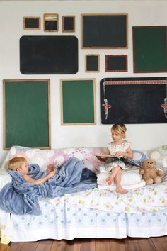 The playroom in this Michigan home used to be a fancy parlor for a state senator. The vintage chalkboards make for a revolving art display.