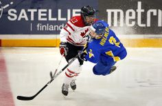 Sweden's Elin Holmlov, right, collided with Canada's Caroline Ouellette at the Women's World Ice Hockey Championships in Hameenlinna, Finland, Monday. (Bob Strong/Reuters)