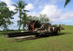 The big guns on Roi-Namur, Marshall Islands.    And in the back my son pretending to shoot them ..