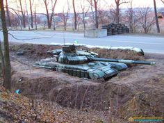 Ukrainian T-64BV in dug-in position.