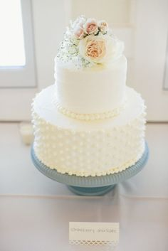 prettiest little white wedding cake with flowers