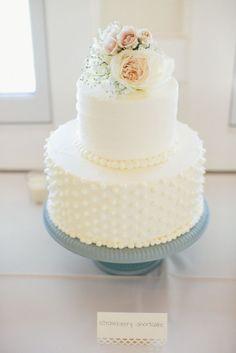 prettiest little white wedding cake with flowers